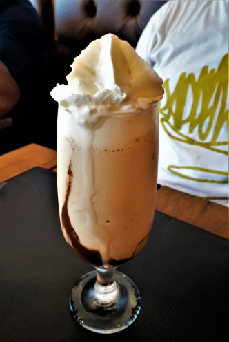 An Ice Coffee with lots of whipped cream