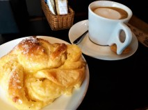 The Raxas de Coco - a Pastry with Coconut and a Café com Leite